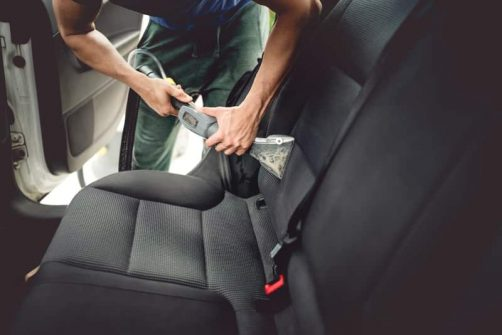 Fayetteville detailer steam cleaning rear car seats