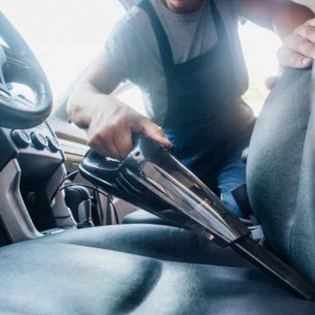 mobile detailer vacuuming the auto interior