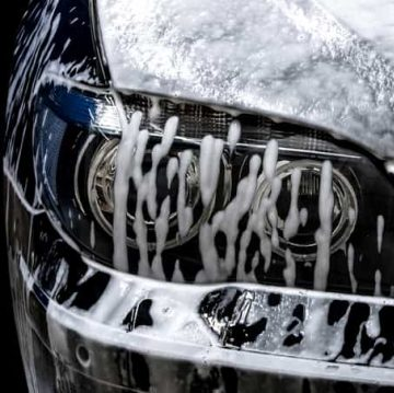 car with it's exterior being washed